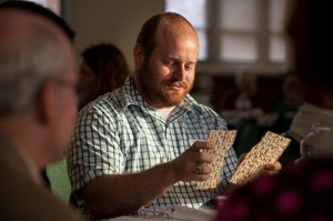 Lisa Johnston | lisajohnston@archstl.org Seth Marton has participated in Seders his whole life, but this Passover he will host one for the first time at his home. Marton broke matzah during the hunger seder at the Cardinal Rigali Center as part of the Arc